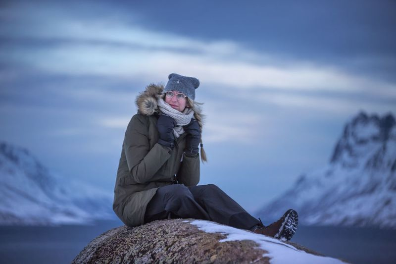 Norway Freeze Traking Girl Fjordsofnorway Fjord EyeEm Selects Winter Cold Temperature Snow One Person Warm Clothing Clothing Cloud - Sky Nature Sky Leisure Activity Mountain Sitting Adult Lifestyles Real People Day Outdoors Hat Snowcapped Mountain