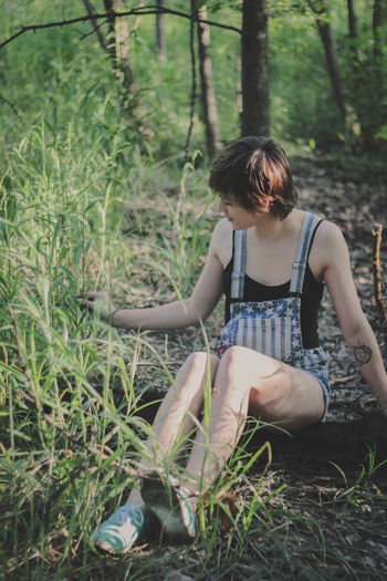 Carefree Casual Casual Clothing Day Everyday Peope Exploring Forest Forest Exploring Forest Walk Hiking Lifestyles Nature Nature Portrait Natural Light Portrait Outdoor Portrait Outdoors Overalls Suburban Tree Young Adult Young Woman Uniqueness