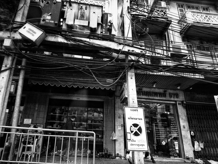 a wired city - Bangkok 2017 Wires Building Exterior Architecture Bw_ Collection Black And White Black & White Bw_collection Streetphotography_bw EyeEm Bnw Black And White Collection  EyeEm Thailand Urban Exploration Dailyphoto Lensculture Lensculturestreets Street Photography Street Life Urbanphotography Xperia Z5 Sony Xperia Dailylife Black And White Collection  Streetphotography Urban Landscape Street
