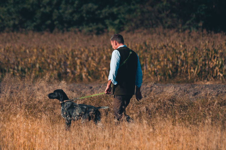 Adult Agriculture Animal Animal Themes Day Dog Domestic Animals Full Length Golden Grainfields Hunting Dog Mammal Nature Photography Nature_collection One Animal One Man Only One Person Only Men Outdoor Photography Outdoors Pets Summer Summertime Vet