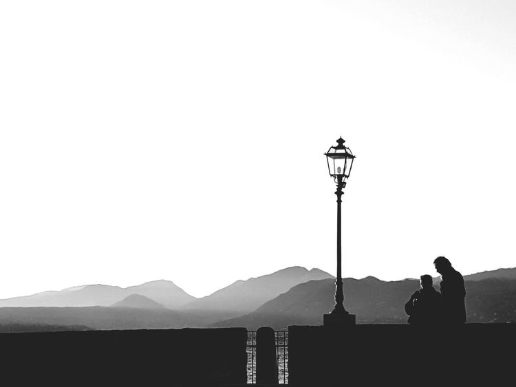 La mia salvezza… vedo meraviglia ovunque.... Tranquility Beauty In Nature Nature Lake Blackandwhite Italy Shadow Biancoenero Monochrome People Photography EyeEm Best Shots B&w Only Men One Person Adults Only Sky Day Street Light Silhouette Clear Sky Mountain