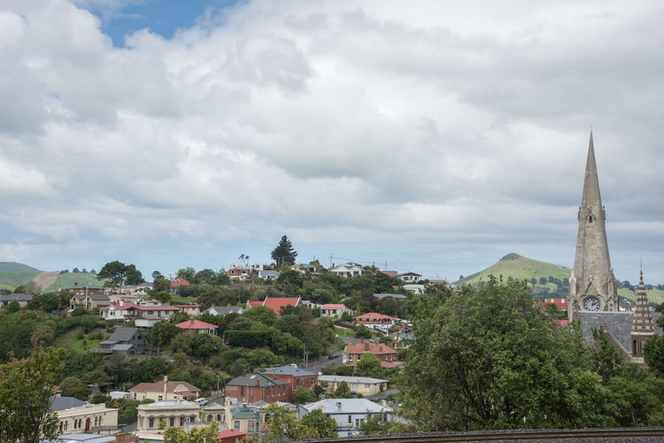 Port Chalmers, Dunedin, New Zealand-December 11,2016: Elevated view over the community architecture in Port Chalmers, Dunedin, New Zealand Church City Community Dunedin Gothic Architecture Building City Cloud - Sky Day Development Elevated View High Angle View Iona Neighborhood New Zealand Place Of Worship Port Chalmers Religion Residential District Spire  Tower Town TOWNSCAPE Tree