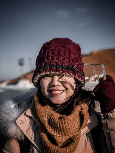 Portrait of smiling woman holding ice