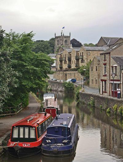 Narrowboats along the canal, Skipton, UK. Skipton NarrowboattCanalssCanal WalkssSkipton CastleeStone BuildingssStone ArchitectureeUrban Landscapee
