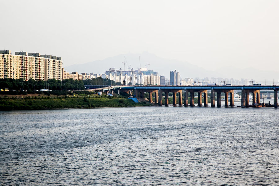 Bridge Bridge - Man Made Structure City Life Cityscape Connection Development Engineering Food Han River Haze In The Afternoon International Landmark Long Mid Distance Ocean Outdoors Pier Railing River Sea Suspension Bridge Urban Landscape Water Waterfront