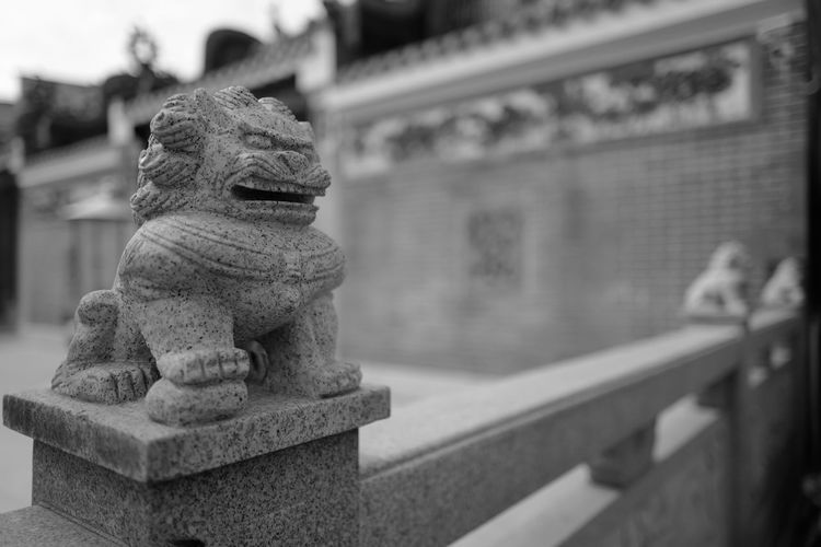 Statue against temple