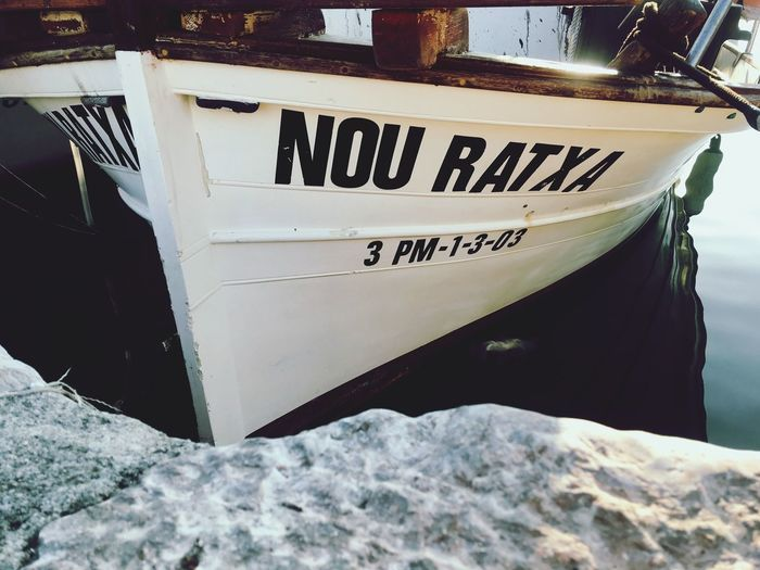 Fishing boat in Port de Pollença Port De Pollenca Mallorca SPAIN Fishing Boat Text Communication Mode Of Transportation Transportation Western Script Winter Snow Day No People Water Outdoors Moored Sign Close-up Nautical Vessel Capital Letter
