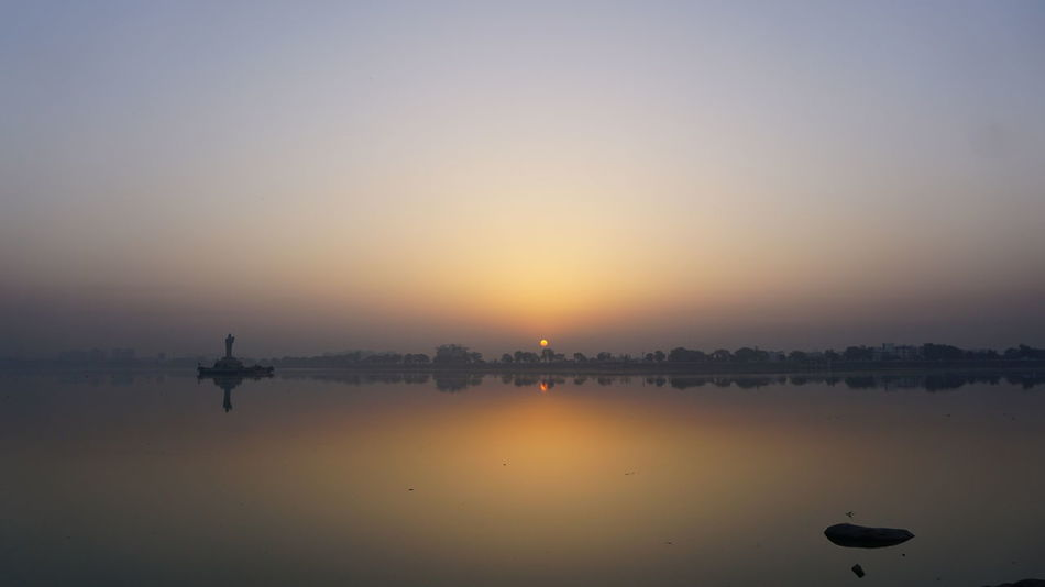 Just Clicked It Travel Destinations Sunset Reflection Tranquility Water Travel Outdoors Silhouette Sky No People Tree Scenics Beauty In Nature Nature Amusement Park Day Incredible India SonyAlpha6000 Nwin Photography Sony A6000 Sunrise Colors Sunrise Collection 2017