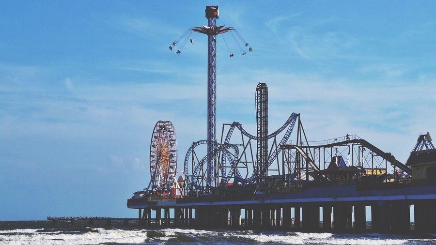 Amusement Park By Sea Against Sky