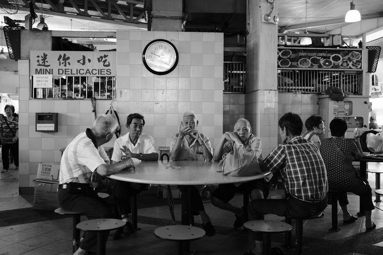 Fujifilm_xseries Fujifilm FUJIFILM X-T2 FujiAcros Streetphotography Streetvendor Street Vendor Street Street Photography Streetphoto_bw Fujinon23mm Fujinon 23mm F1.4 Noiretblanc Clock Arts Culture And Entertainment Full Length Sitting Happy Hour Food And Drink Establishment My Best Travel Photo EyeEmNewHere