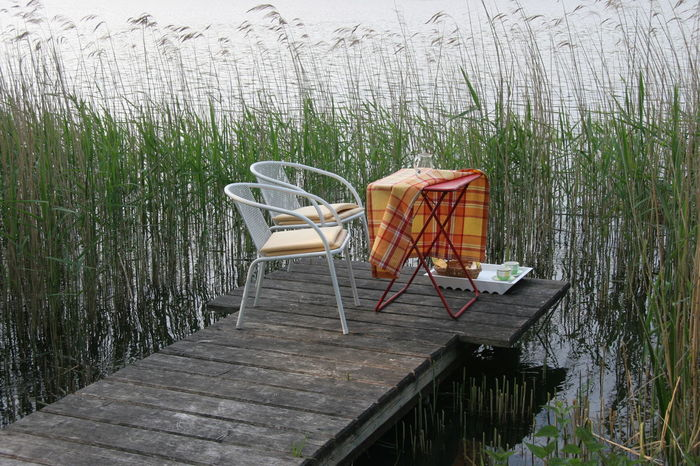 Chair Day Grass Nature No People Outdoor Chair Outdoors Picknick Table Picknick Time Romantic Water