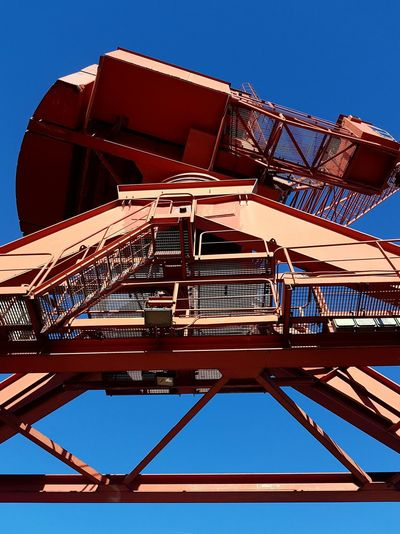 Crane Industrial Area Sky Blue Sky Red Crane Outdoors No People Day Business Stories