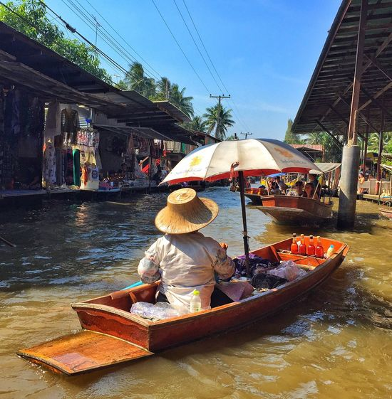 Finding New Frontiers Nautical Vessel Mode Of Transport Transportation Real People Outdoors Boat Retail  Tree Sunlight Water Asian Style Conical Hat Sky Sitting Day River Market Women Men Rowboat One Person Floating Market Thailand Tourist Destination