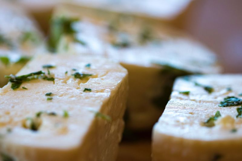 Cheese Selective Focus Food And Drink Freshness No People Indoors  Close-up Food Table Chopping Board Ready-to-eat Day Piece Differential Focus Food And Drink Primo Sale Cheese Factory Freshness
