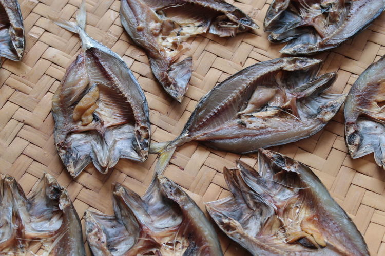 High angle view of dried fish on wicker plate