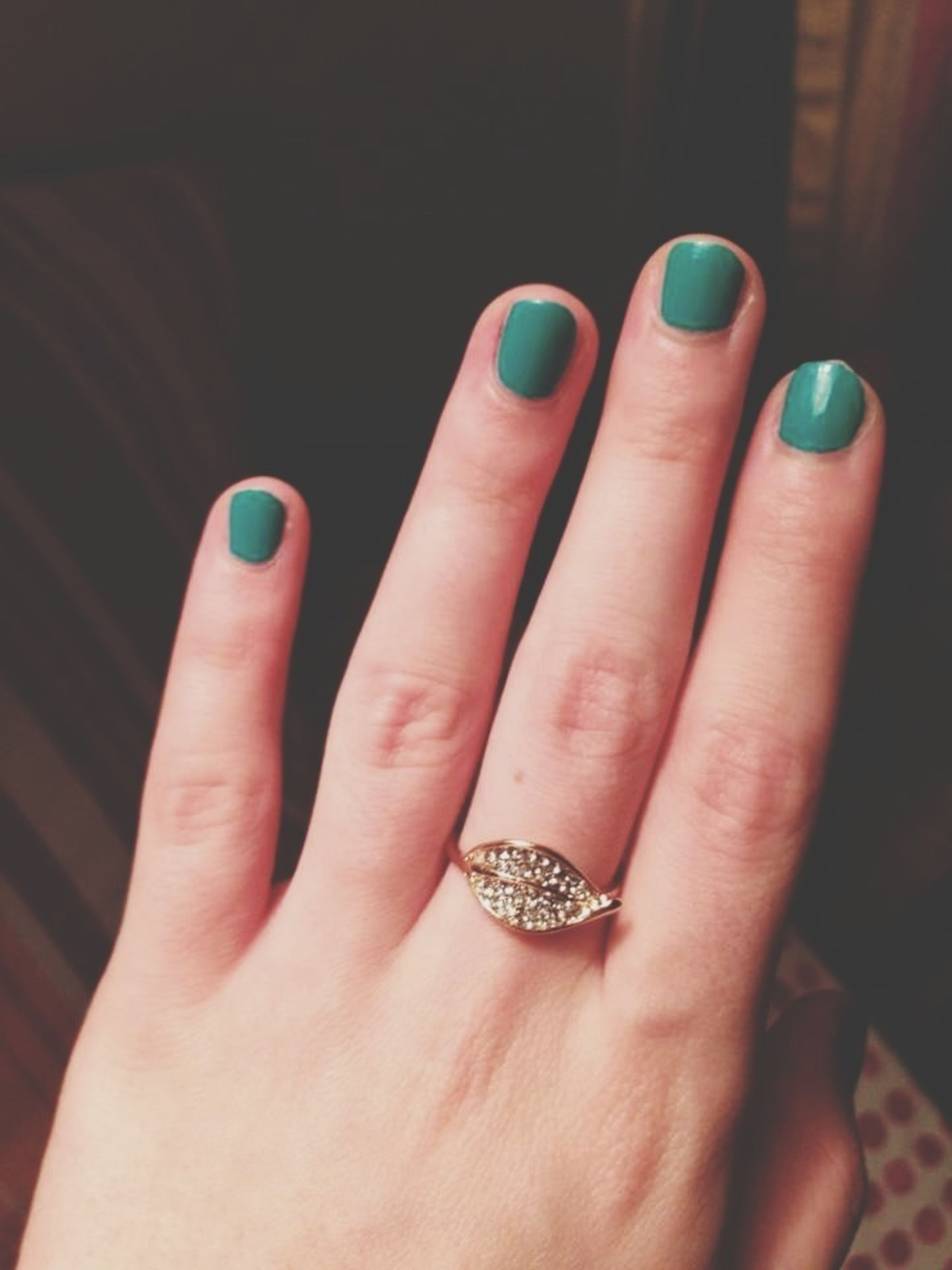 person, part of, indoors, human finger, holding, close-up, cropped, ring, unrecognizable person, jewelry, personal perspective, fashion, high angle view, nail polish, bracelet, studio shot, showing