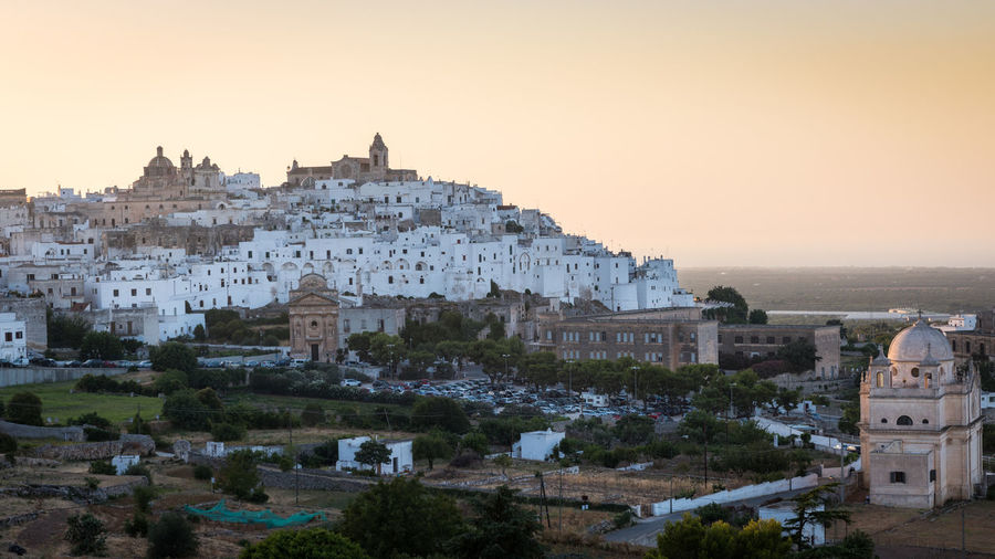 Beautiful Ostuni during summer sunset Italy City Sunset Summer Sea Vacation Tourism Travel Destinations Cityscape Clear Sky Architecture Building Exterior Built Structure Residential District Town