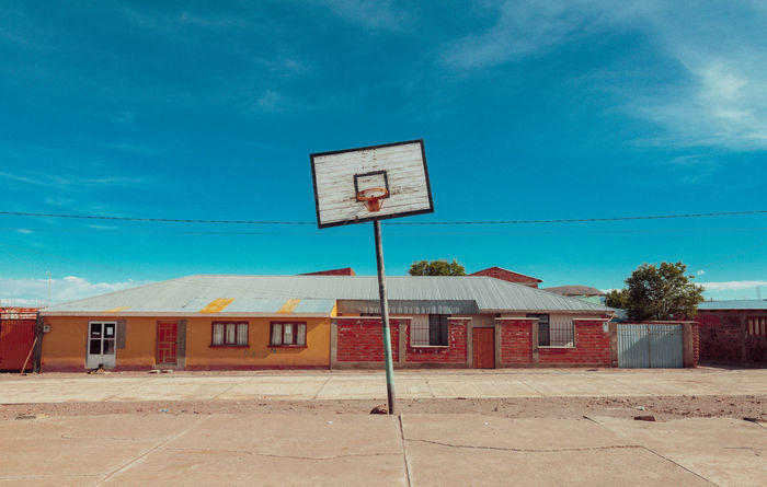 Architecture Basketball - Sport Basketball Hoop Blue Bolivia Building Exterior Built Structure Cloud - Sky Court Day Horizontal No People Outdoors Sky Sky And Clouds Small Town Sport Symmetry Tristesse Live For The Story