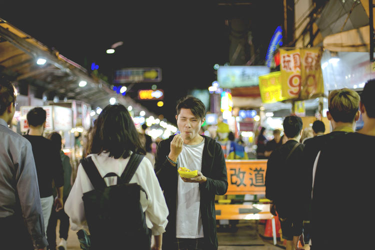 People standing in market at night