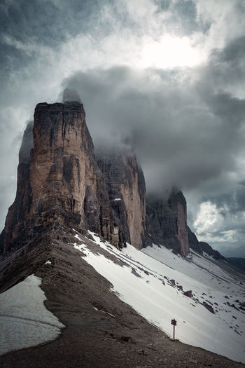 The Tre Cime di Lavaredo, Italy. Mountain Cloud - Sky Sky Beauty In Nature Nature Scenics - Nature No People Outdoors Tranquil Scene Italy Dolomites Dolomites, Italy Tre Cime Di Lavaredo Drei Zinnen Day Rock Environment Landscape Non-urban Scene Rock Formation Physical Geography Cold Temperature Tranquility Solid Snow Formation Snowcapped Mountain Mountain Peak