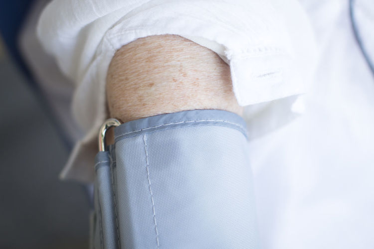 Close-up of person wearing blood pressure gauge