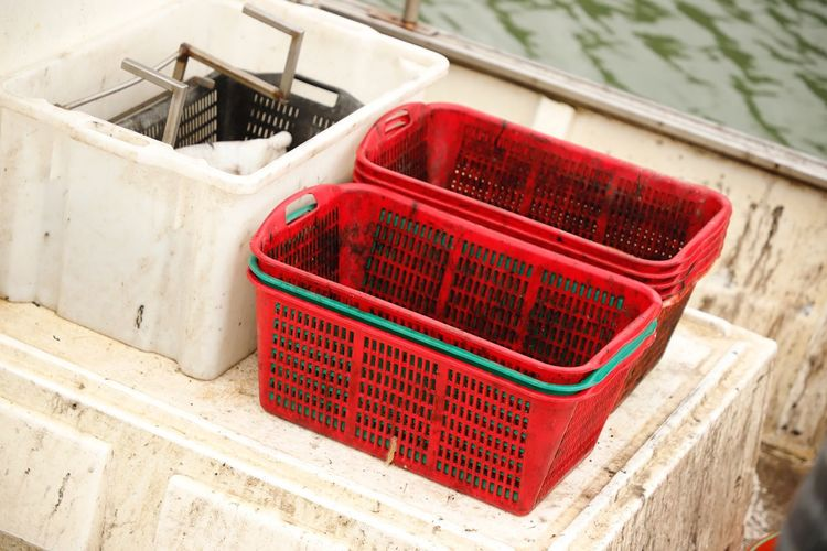 Italy Cervia Harbor Harbour Fishermens Boat Equipment Fishermens Equipment Red Water Travel Travel Destinations Traveling Basket Container No People Day High Angle View Outdoors Architecture Built Structure Close-up Nature Focus On Foreground Plant Pattern Wall - Building Feature Staircase Green Color Wicker