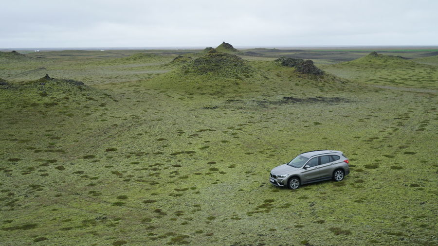 BMW X3 stops at remote location in Iceland 4x4 Green SUV Travel Beach Beauty In Nature Bmw Car Day Horizon Over Water Land Vehicle Landscape Nature No People Outdoors Remote Road Sand Scenics Sea Sky Tranquil Scene Tranquility Transportation X