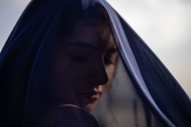 Close-up of woman covered with navy blue textile
