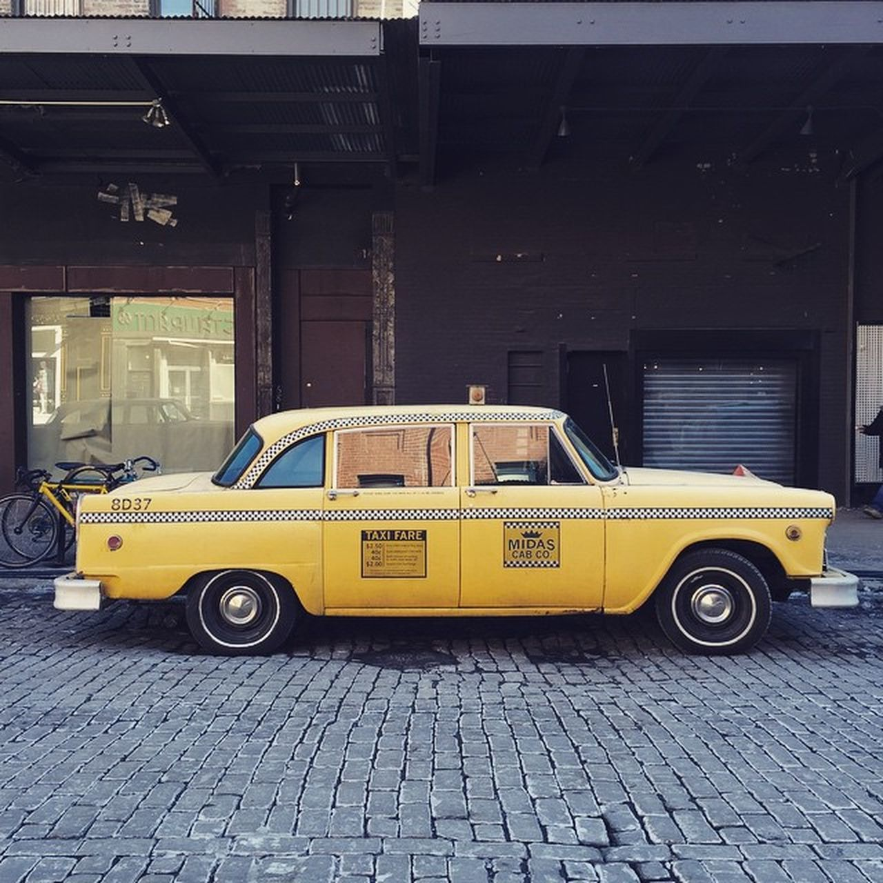 car, taxi, street, transportation, mode of transport, yellow, outdoors, land vehicle, day, no people, stationary, architecture, building exterior, city