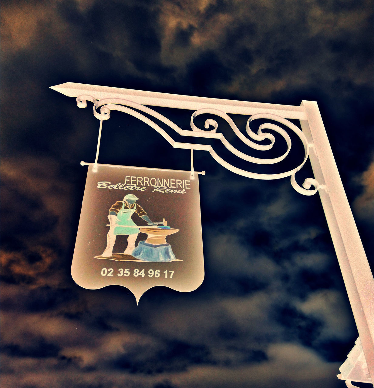 communication, text, sign, focus on foreground, low angle view, cloud - sky, western script, no people, sky, information, nature, information sign, guidance, hanging, outdoors, human representation, day, symbol, close-up, road sign