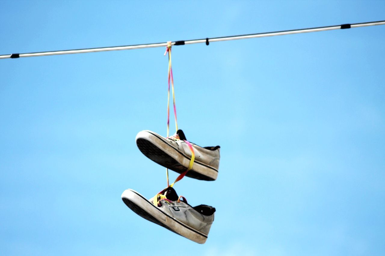hanging, blue, clear sky, day, low angle view, outdoors, sunlight, no people, cable, sky, nature, ski lift