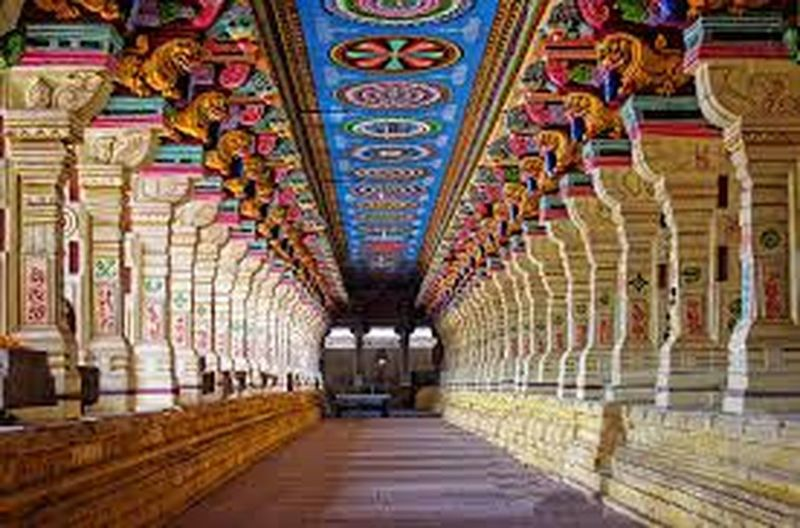 It is multi colored temple corridor built Pandave is stone pillars with sculptures in one line beautifully colored Architecture
