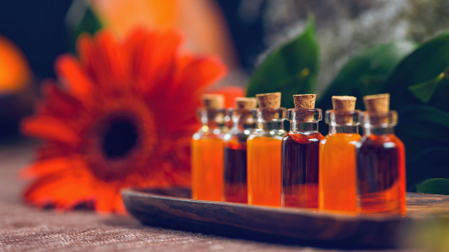 Aromatherapy Aromatherapy Aromatherapy Oil Essential Oils Orange Red Bottles Spa Wellness Relax Glass Therapy Blue Natural Aromatic Brown Care Treatment Healthy Perfume Candles Essence Green Fragnance Organic Health Aroma Fresh Alternative Relaxation Lifestyle Decoration Cosmetic Ingredient Skincare No People Close-up Bottle Table 16x9 Glass - Material Indoors