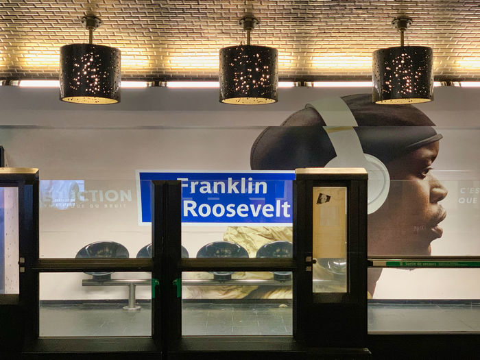 France, Paris: in a subway station: Franklin D Roosevelt Paris France Train Station Train Station Platform Advertisement Text No People Lighting Equipment Communication Human Representation Indoors  Male Likeness Western Script Window Representation Store Mannequin Illuminated Architecture Art And Craft Glass - Material Retail  Retail Display Information Business Ceiling