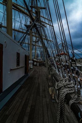 Sailboat on pier against sky
