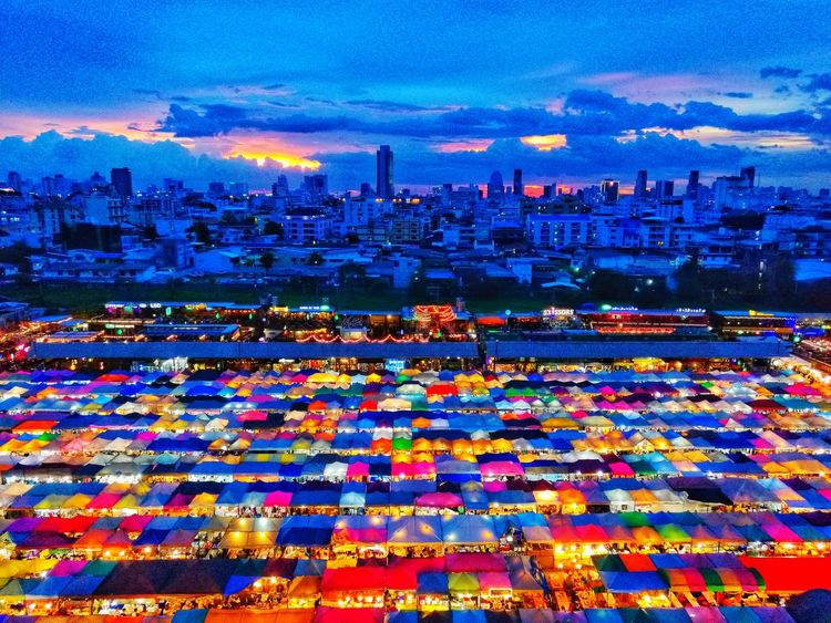 Night Market in BangkokThailand Sunset Sunlight Sunrise Sunset Silhouettes Market Umbrella Clouds And Sky City Illuminated Cityscape Urban Skyline Multi Colored Backgrounds Sky Architecture Building Exterior Snow Covered Firework - Man Made Object Ice Rink Hot Air Balloon Ice Hockey Stick Ballooning Festival TOWNSCAPE