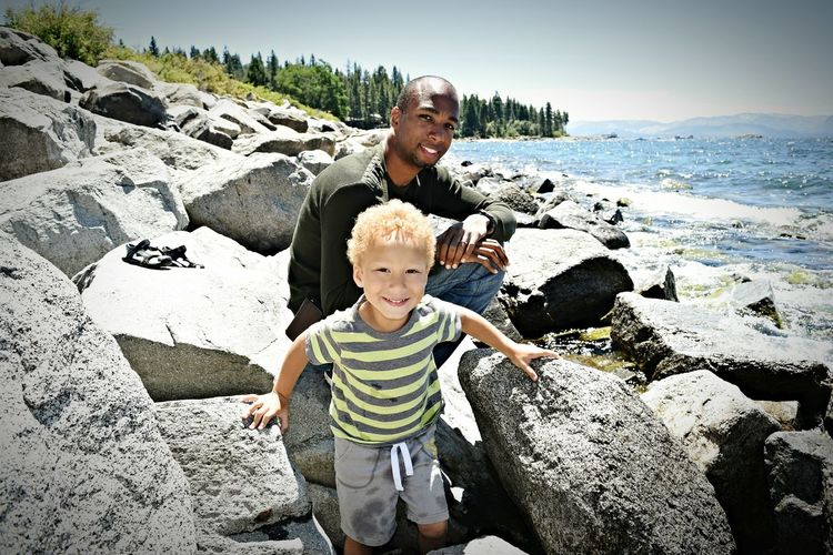 Come to Lake Tahoe - Father and Son photo Fatherhood Moments Lake Tahoe Rocks And Water Inviting Childhood Family Enjoyment Cute Vacations Smiling Boy Dad Daddy Fun California Multi Racial Father Son Moments Shore Coast Shore Rocky Happy Sunny