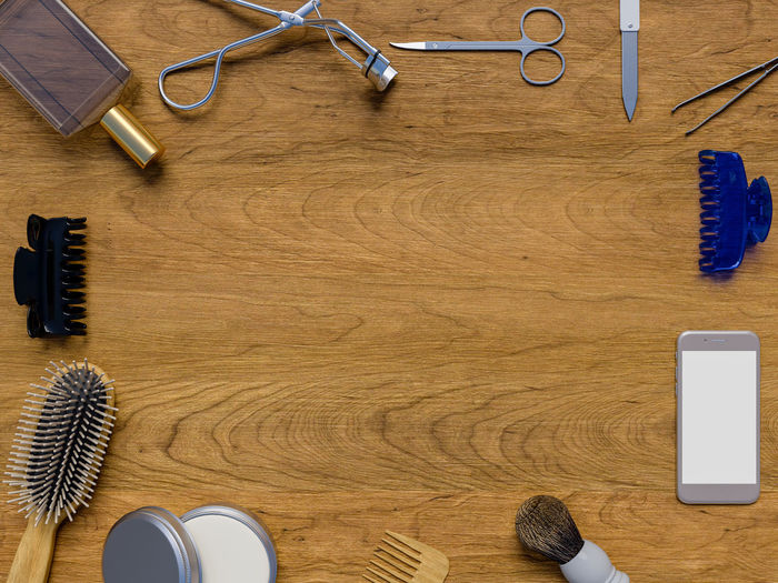 Cosmetic accessories on wooden. Eyeshadow Accessories Arrangement Beauty Blank Brown Choice Communication Connection Cosmetics Directly Above Equipment High Angle View Luxury No People Occupation Scissors Smart Phone Still Life Table Technology Variation Wood Wood - Material Wood Grain