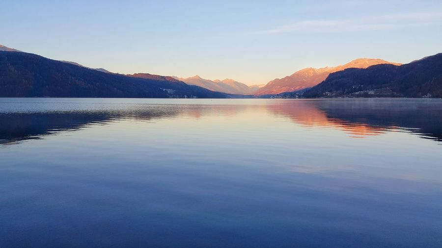 Millstättersee Morning Beauty In Nature Blue Carinthia Clear Sky Idyllic Lake Lake View Landscape Millstatt Mountain Mountain Range Nature No People Outdoors Reflection Scenics Sky Sunrise Sunset Tranquil Scene Tranquility Water Waterfront