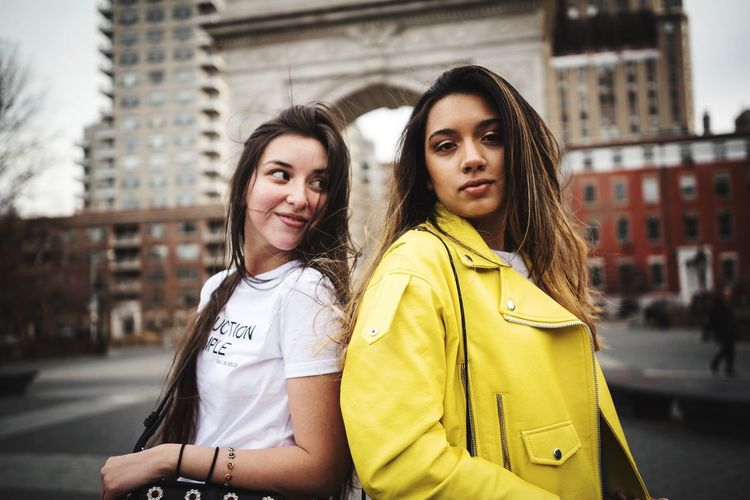 Lifestyles Fashion City Street City Life Two People Friendship Yellow Building Exterior Portrait Beautiful People Outdoors Lifestyles Women Young Adult Togetherness Looking At Camera Beauty Young Women Beautiful Woman Adult Real People