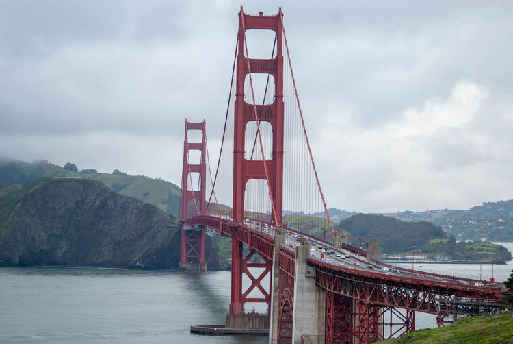 Bridge Bridge - Man Made Structure Built Structure Sky Transportation Architecture Engineering Water Connection Suspension Bridge Cloud - Sky Nature Day Mountain Bay Red Travel Travel Destinations Mountain Range Outdoors Golden Gate Bridge