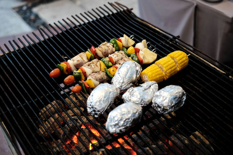Barbecue party near pool Plant Barbecue Barbecue Grill Burning Close-up Coal Day Fire Fire - Natural Phenomenon Food Food And Drink Freshness Grilled Healthy Eating Heat - Temperature High Angle View Meat No People Outdoors Party Pool Preparation
