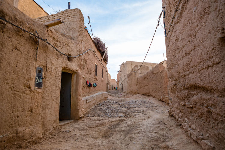 Atlas Bumpy Road Moroccan Landscape Morocco Rural Architecture Atlasmountains Building Exterior Clay Clay Houses Landscape Mountains Mountains And Sky No People Rough Rural Landscape Street Travel Destinations