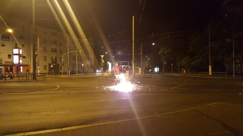 Working hard at night. Sparks Sparks Fly Tram Train Worker Construction Berlin Tracks
