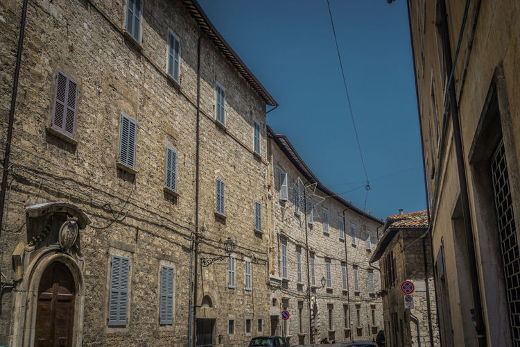 Ascoli Piceno Architecture Blue Building Building Exterior Built Structure City Clear Sky Day History Italy Lighting Equipment Location Low Angle View Nature No People Old Outdoors Place Residential District Sky Street Sunlight Window