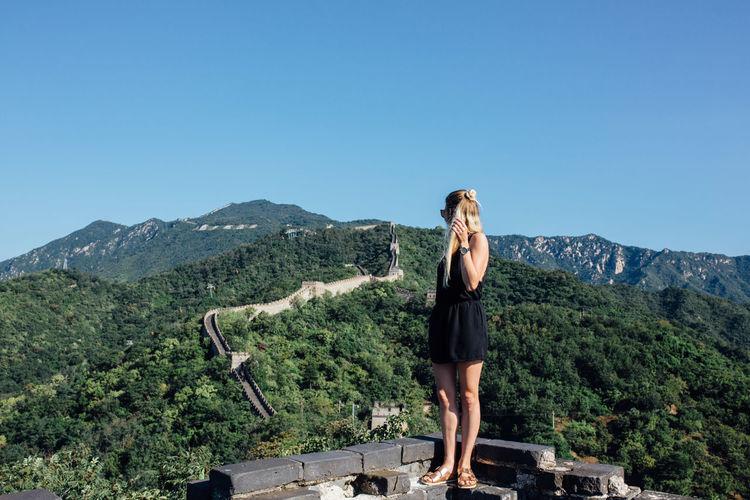 Woman standing at great wall of china