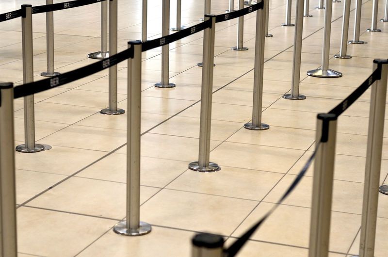 Security Waiting Absence Airport Architecture Consumerism Convenience Day Entrance Flooring Glass - Material High Angle View Indoors  Metal Modern No People Railing Safety Security Staircase Steps And Staircases Tile Tiled Floor