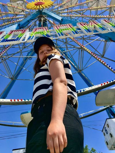 Leisure Activity Amusement Park Amusement Park Ride Real People Lifestyles Day Casual Clothing Arts Culture And Entertainment Enjoyment Looking Low Angle View Childhood Outdoors Girls Child Nature Outdoor Play Equipment