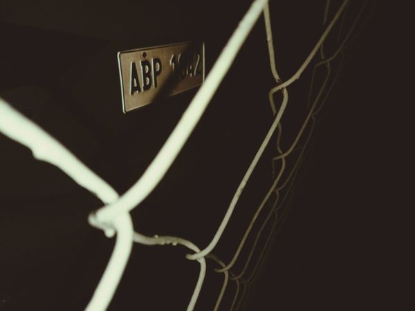No People Studio Shot Black Background Close-up Night urban Urban Geometry Chainlink Fence Fence Car License Plate White Fence