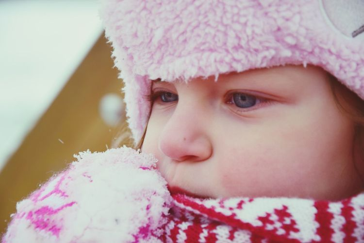 Close-Up Of Cute Baby Girl Wearing Knit Hat